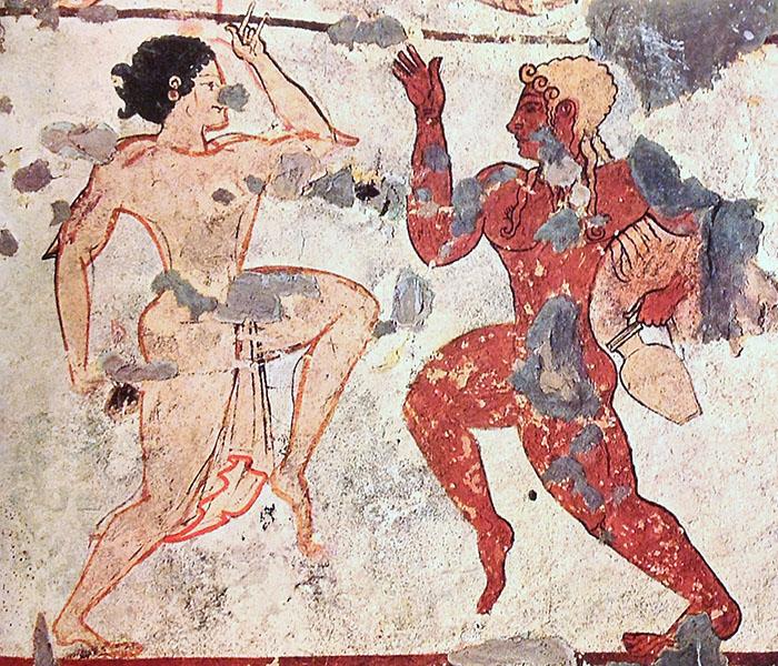 """tomba delle leonesse_tarquinia_monterozzi_detail - Das Detail zeigt die tanzende Frau mit dem bis heute bekanntem Zeichen gegen den """"Bösen Blick"""". Foto: Wikipedia, Gian Luca Ferme"""