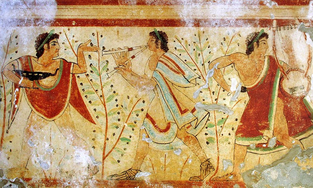 Tomba dei Leopardi_tarquinia_Dancers and musicians - Das Fresko aus Tarquinia zeigt in der Tomba dei Leopardi etruskische Musiker und Tänzer beim Symposium. Es datiert auf die erste Hälfte des 5. Jahrhunderts v. Chr. Foto: Wikipedia, Yann Forget
