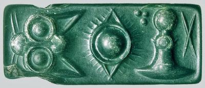 Bronzezeit auf Kreta: Die Paläste der Minoer waren Basis ihrer Städte Pini-plombe, Jaspis Siegel, kretischen Hieroglyphen, 1800 v. Chr Der Siegelstein aus grünem Jaspis wurde mit kretischen Hieroglyphen beschriftet und datiert auf um 1.900/1.800 v. Chr. Das vierseitige Prismasiegel wird Pini-Plombe genannt. Foto: Wikipedia, Ingo Pini