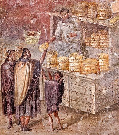 fresko, brotverteilung durch einen aedilen_haus des bäckers_pompeij_ol Brotverteilung an das Volk durch einen plebejischen Aedilen, einem Beamten der mit Toga bekleidet ist. Fundort: Pompeji. Ausstellungsort: Archäologisches Nationalmuseum von Neapel. Foto: Wikipedia, Marie-Lan Nguyen