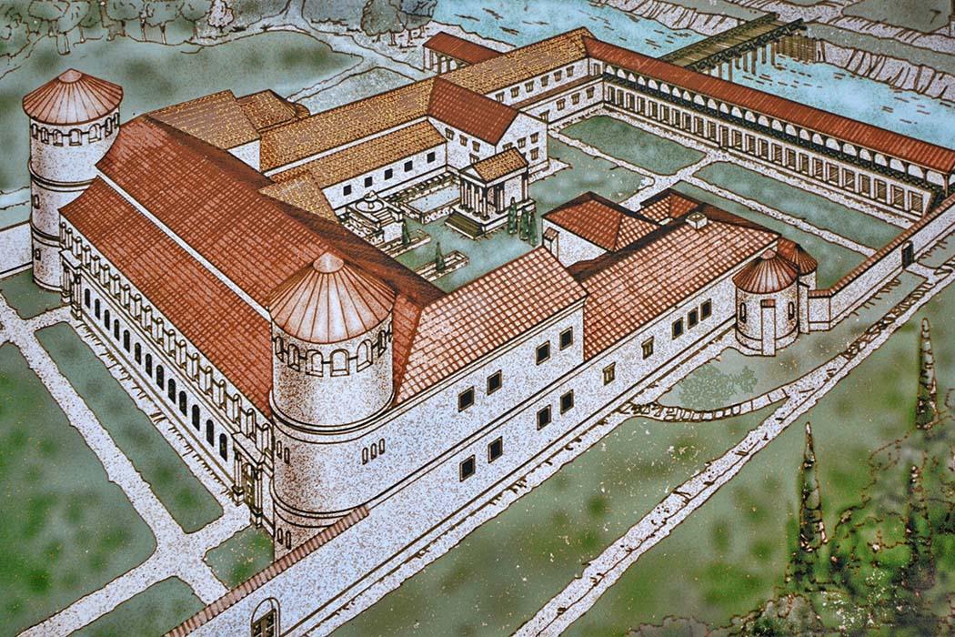 Governors_Palace_of_Aquincum_Budapest Rekonstruktionszeichnung des Gouverneurspalastes von Aquincum, den Hadrian ab 107 erbauen ließ. Der von einer Mauer umgebene Palast umfasste die Residenz des Gouverneurs, Empfangs- und Serviceräume und Lagerhäusergebäude. Foto: Wikipedia, Carole Raddato